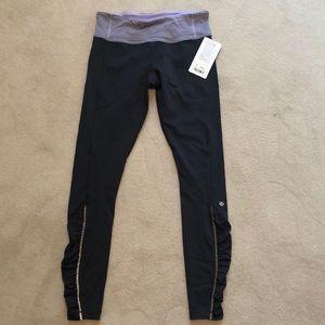 New grey Lululemon leggings, size 10.
